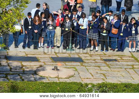 ARLINGTON, VA - APRIL 25, 2014: President John Fitzgerald Kennedy Gravesite in Arlington National Cemetery. The Gravesite is one of the prominent tourist attraction points in the Nation's Capital.