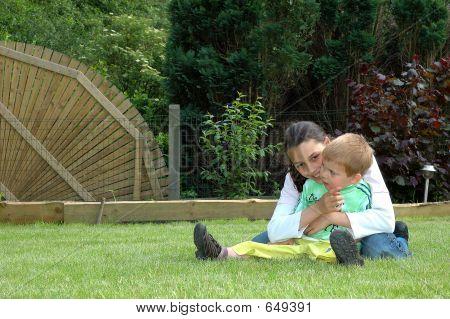Children Playing In Garden.