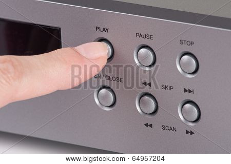 Finger Hitting The Play Key