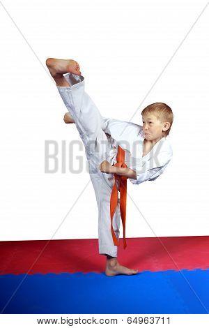 Beautiful kick yoko-geri makes an athlete on a white background