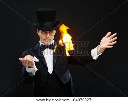 magic, performance, circus, show concept - magician in top hat showing trick with fire poster