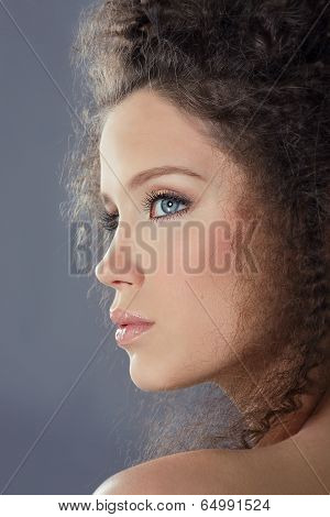 Profile Of Young Brunette Fashion Model With Frizzy Hair
