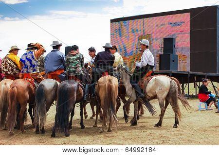 Horseback Spectators In Front Of TV Screen, Nadaam Horse Race