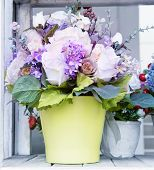flowers bouquet in green jug arranged for decoration in home use for multipurpose beautiful background backdrop poster