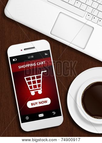 Mobile Phone With Shopping Card Page, Mug Of Coffee And Laptop Keybaord