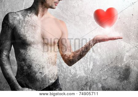 Front of a man raising his hand with a heart above it, picture tarnished