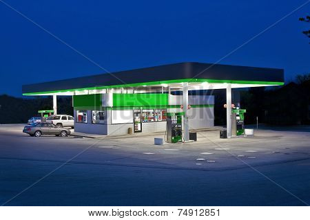 Retail Convenience Store At Night And Gas Station