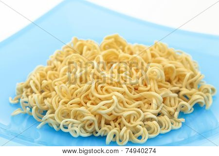 Noodles In Colorful Dish On White Background