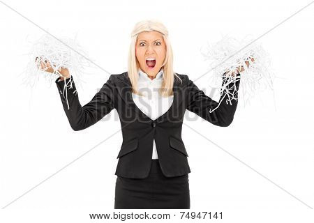 Outraged businesswoman holding a shredded document isolated on white background