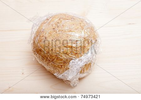 Ready Shaped Dough Ball Wrapped In Plastic Wrap