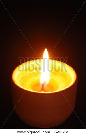 Burning Candle Isolated On Black