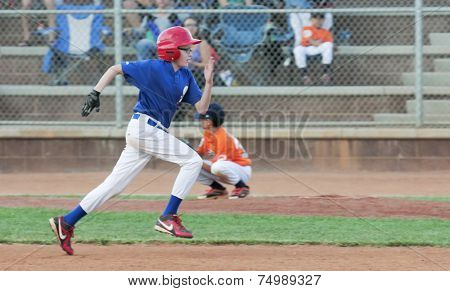 A Runner Attempts To Steal A Base