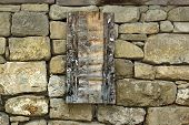 Vintage Wooden Signboard on Old Stone Wall. Background and Texture for text or image poster