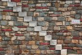 Old White Stone Stairs and multicolored Stonework Wall. Background and Texture for text or image poster