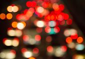 Blur bokeh of traffic jam in city at night background poster