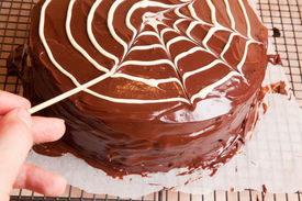 Making Spiders Web On The Chocolate Cake