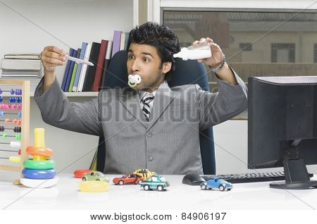 Businessman behaving like a kid in an office poster