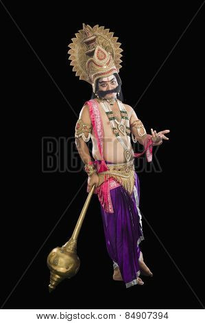 Portrait of a stage artist dressed-up as Ravana the Hindu mythological character and holding a mace poster