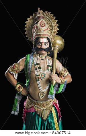 Portrait of a person dressed-up as Ravana the Hindu mythological character and holding a mace poster