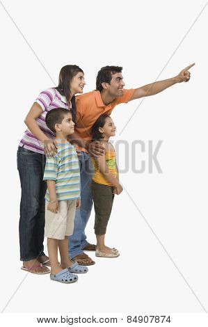Parents standing with their children and pointing