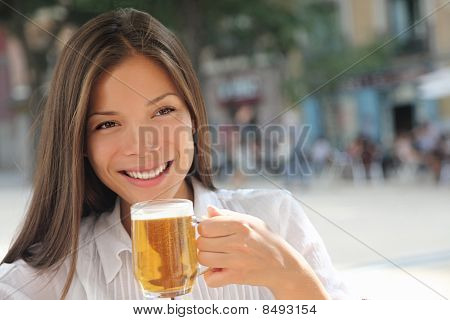 Woman Drinking Beer At Cafe