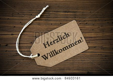 Close Up Of Label With German Text Herzlich Willkommen