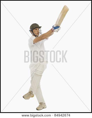 Cricket batsman playing a hook shot poster