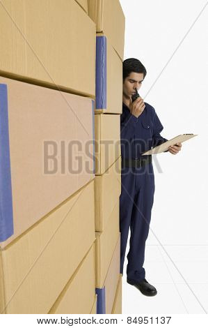 Store incharge talking on walkie-talkie in a warehouse poster