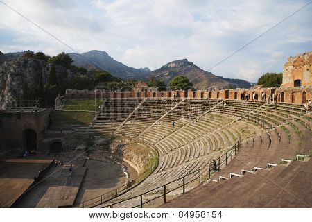 Tourists at ancient Greek theatre, Taormina, Province of Messina, Sicily, Italy