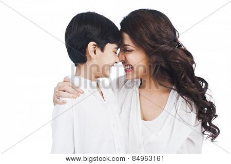 Happy mother and son nuzzling
