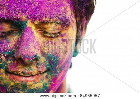 Man's face covered with powder paint during Holi festival