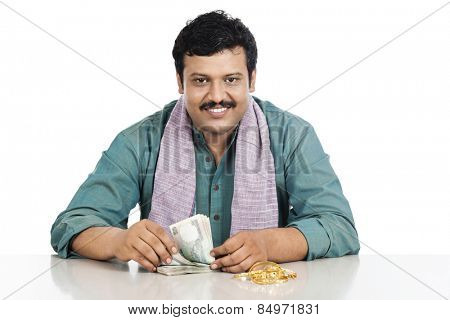 Portrait of a man counting money and smiling