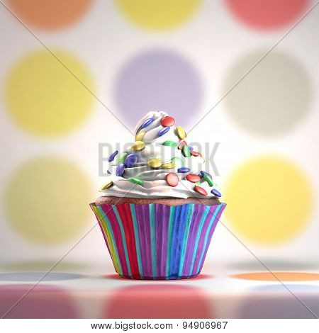 Delicious cupcake with smarties on a whipped cream.