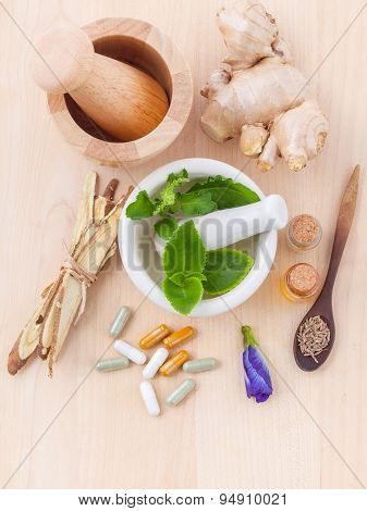 Alternative Health Care Fresh Herbal ,dry Herbal And Herbal Capsule With Mortar On Wooden Background