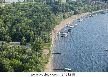 Aerial View Of Lakeshore With Docks And Boats In Minnesota