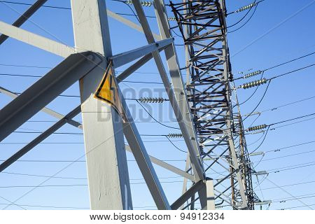 Electricity Pylons With Warning High Voltage Sign