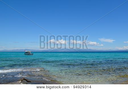 Fishing Boat On The Clear Waters Of The Mediterranean Sea