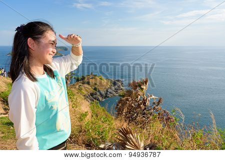 Women Tourists Looking At Beautiful Nature Sea