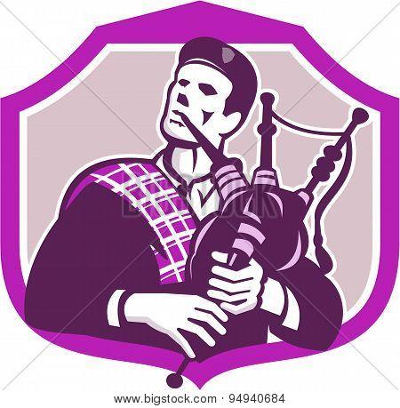 Scotsman Playing Bagpipes Shield Retro