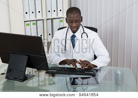 Male Doctor Working On Computer