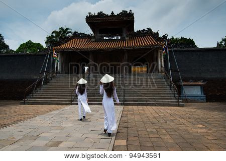 Vietnamese girls with Ao Dai in Tu Duc royal tomb in Hue, Vietnam