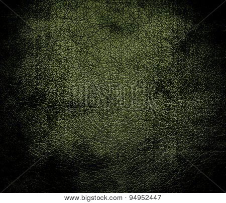 Grunge background of army green leather texture