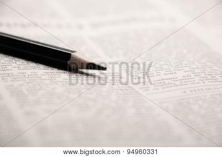 Pencil On Newspaper