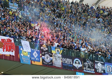 WARSAW POLAND - MAY 27 2015: FC Dnipro team ultra supporters (ultras) show their support during UEFA Europa League Final game against Sevilla at Warsaw National Stadium poster