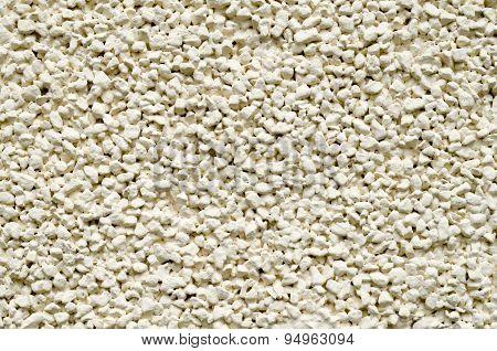 Ecru Plaster From Pebbles On Wall Closeup