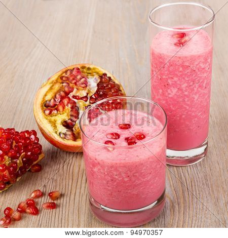 Strawberry and pomegranate healthy smoothie. Isolated on wooden background. Healthy bio organic vegan drink. poster