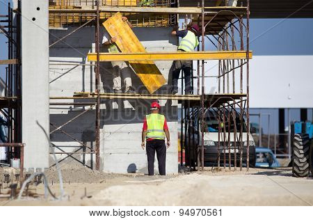 Workers On Scaffolds