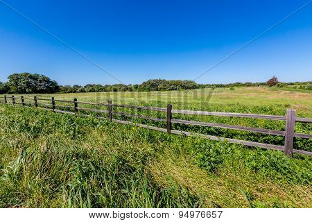 A Wide Angle View Of A Beautiful Texas Field with Old Fence