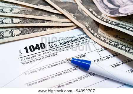 1040 individual tax return form and american dollar bils