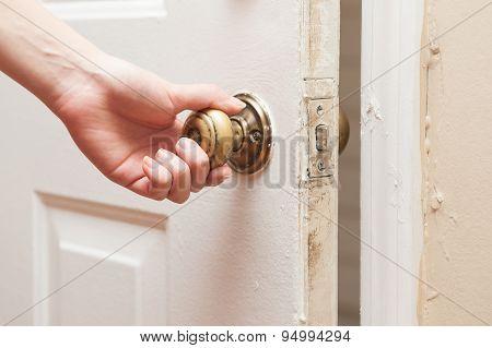 Hand opening the door